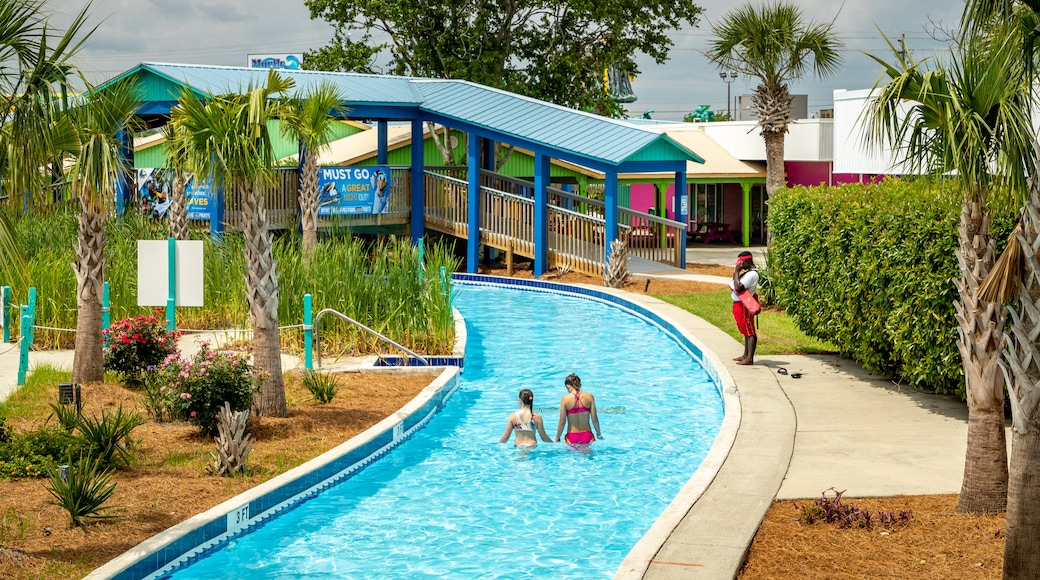 Myrtle Waves showing swimming and a waterpark as well as a couple