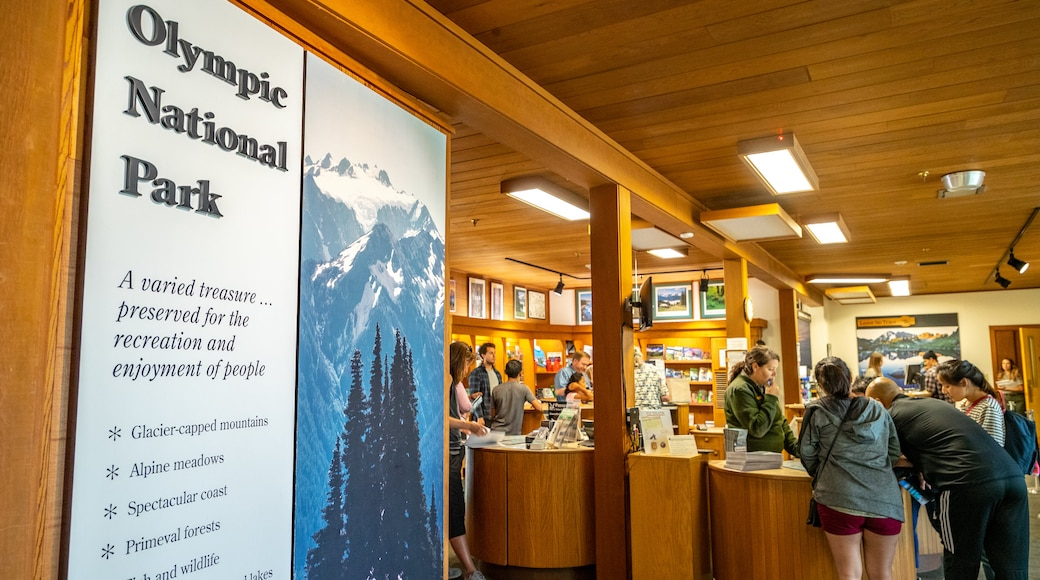 Olympic National Park Visitor Center featuring interior views and signage as well as a small group of people