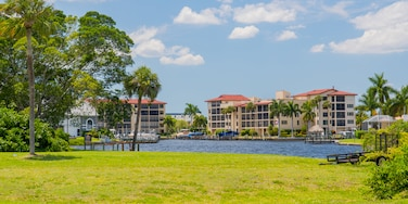 Cape Coral which includes a lake or waterhole and a garden