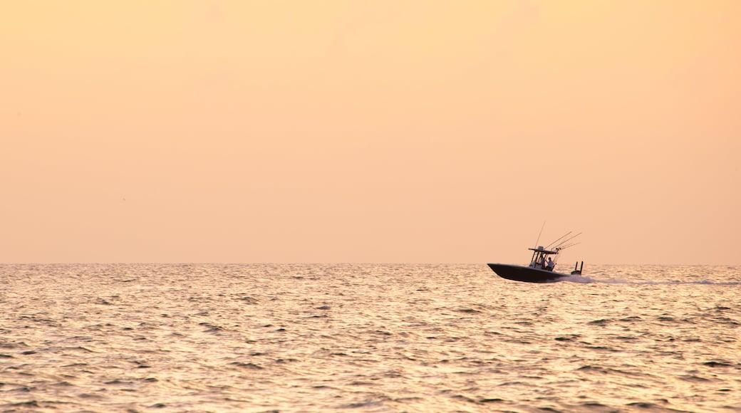 Treasure Island showing boating, a sunset and general coastal views