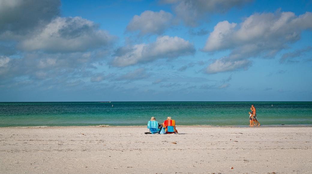Treasure Island featuring general coastal views and a sandy beach as well as a couple