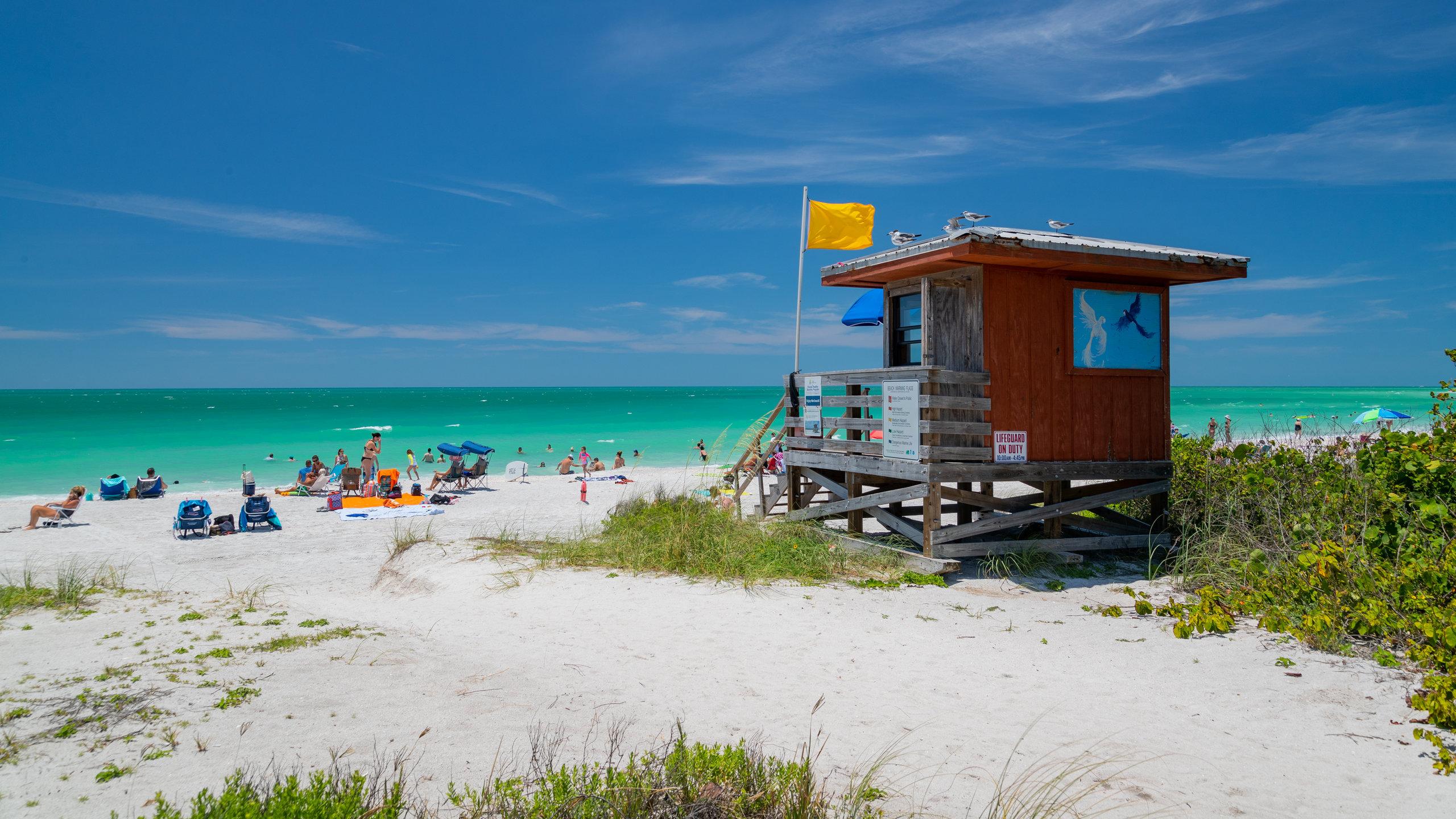 Hva med å tilbringe en avslappende ettermiddag på Lido Beach under turen til Sarasota? Området har hager og nydelige solnedganger du bør få med deg.
