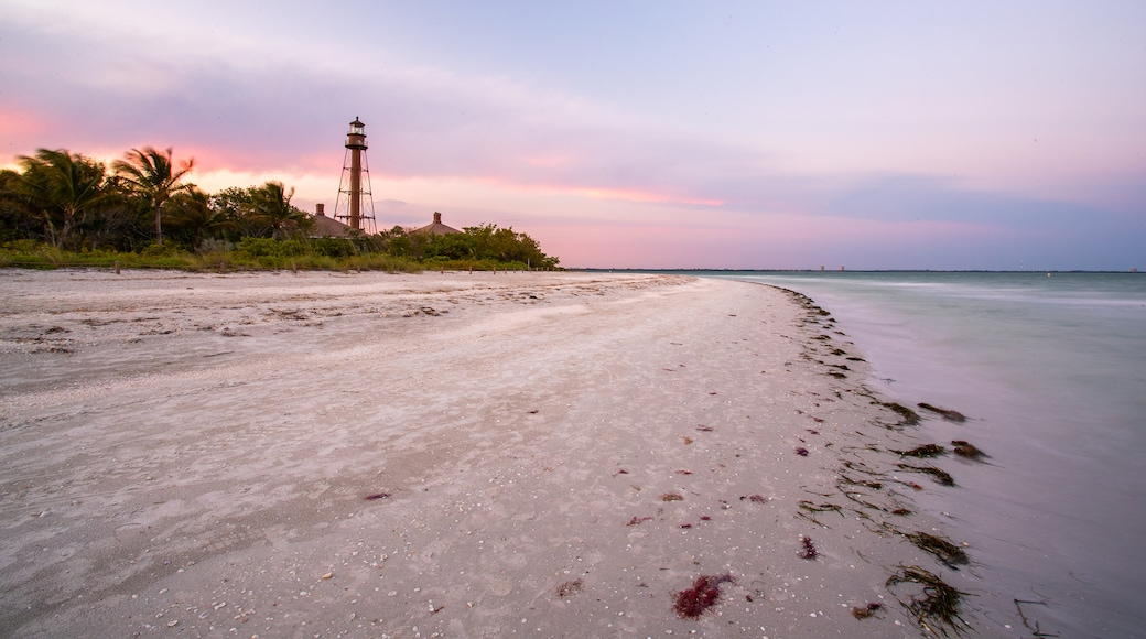 Sanibel Island Lighthouse which includes a beach, general coastal views and a sunset