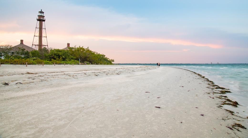 Sanibel Island Lighthouse showing a lighthouse, a sandy beach and a sunset