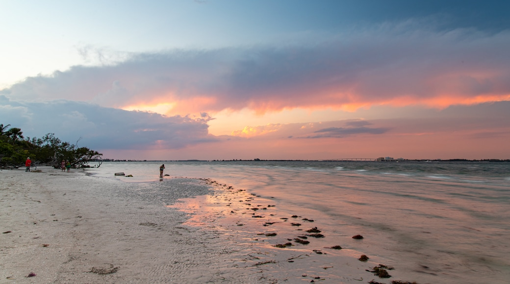 Sanibel Island Lighthouse which includes general coastal views, a sunset and a sandy beach