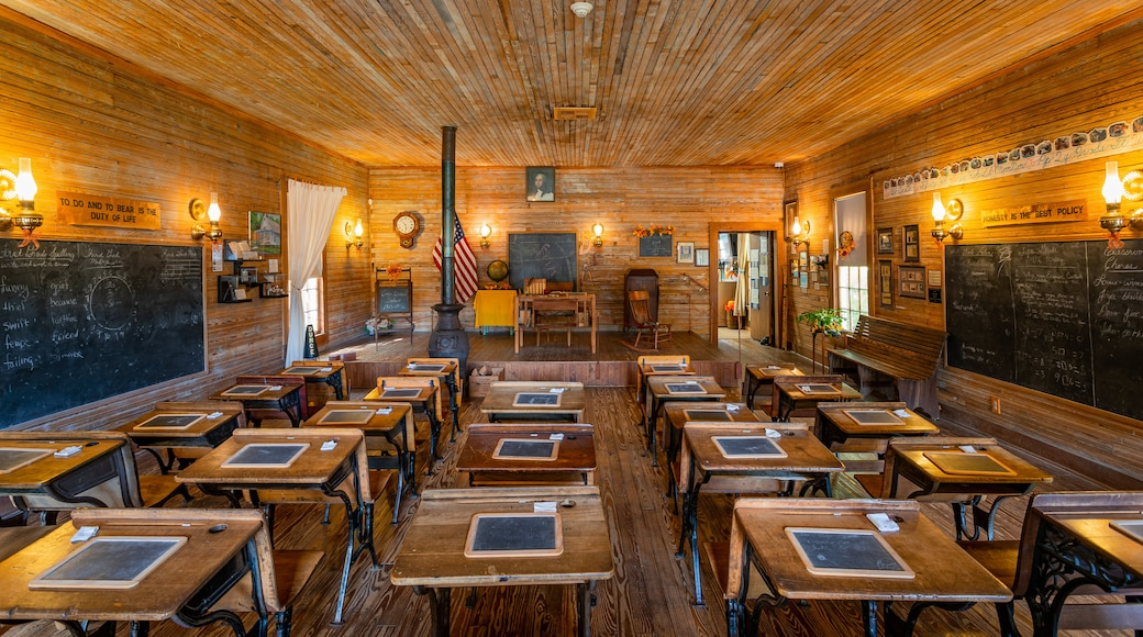 Camp Walton Schoolhouse Museum which includes interior views and heritage elements