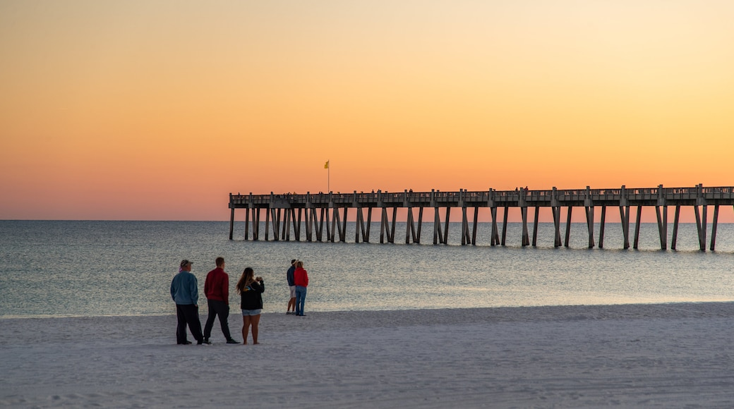 Pensacola Beach which includes a beach, a sunset and general coastal views