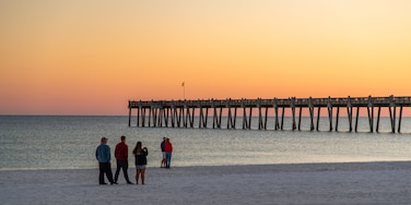 Pensacola Beach which includes a beach, a sunset and general coastal views