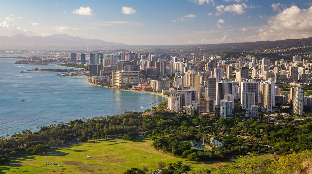 Diamond Head showing a sunset, a coastal town and landscape views