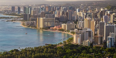 Diamond Head which includes a city, landscape views and a sunset