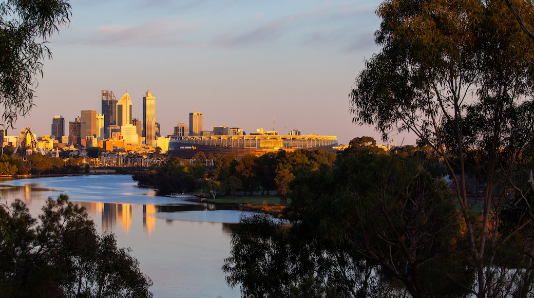 Optus Stadium showing a city, a sunset and a river or creek