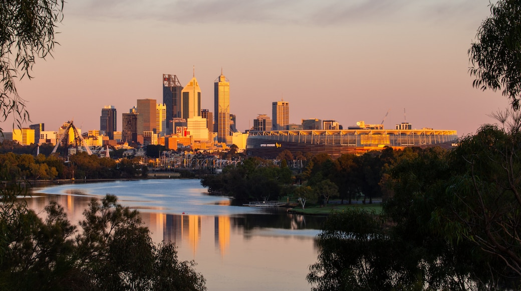 Perth showing a city, a sunset and a river or creek