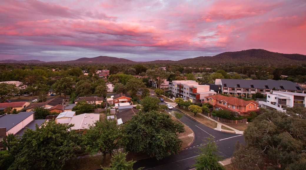 Braddon featuring a small town or village, landscape views and a sunset