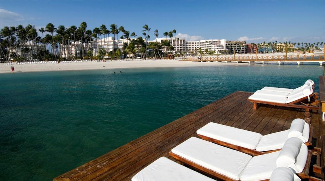 Juan Dolio which includes a beach, views and a coastal town