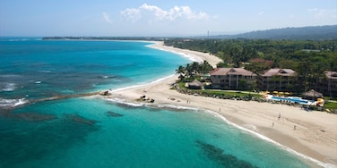 Cabarete which includes a sandy beach, general coastal views and tropical scenes