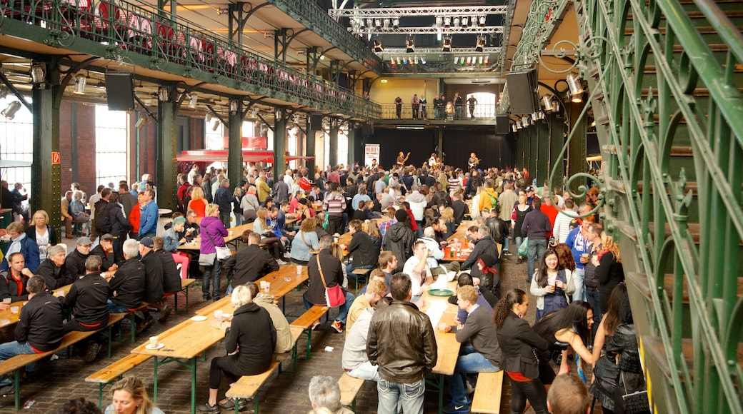 Fish Market which includes markets and interior views as well as a large group of people