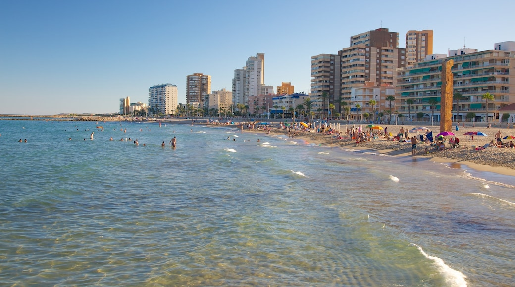 Campello Beach which includes swimming, a coastal town and a luxury hotel or resort