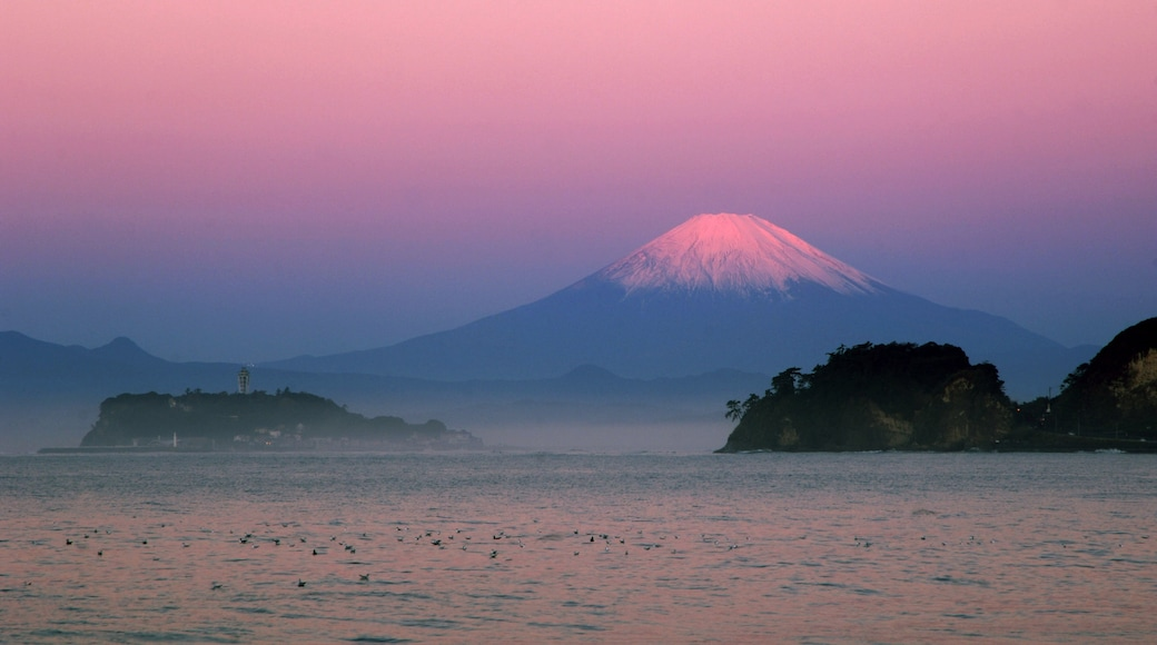 Kamakura which includes general coastal views, a sunset and landscape views