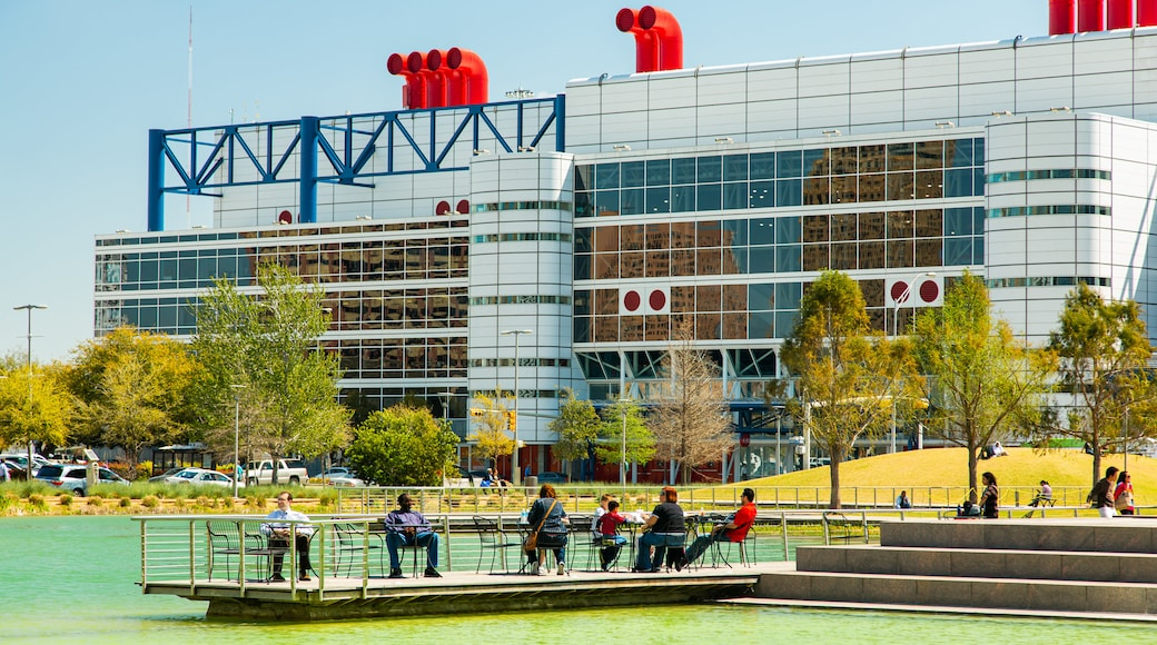 Discovery Green which includes a river or creek as well as a small group of people