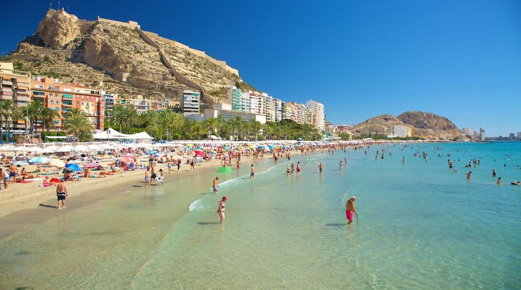 Playa de Postiguet mostrando natación, vistas panorámicas y una localidad costera