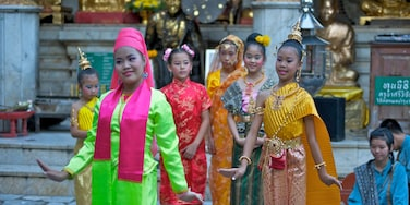 Chiang Mai featuring performance art and fashion as well as a small group of people
