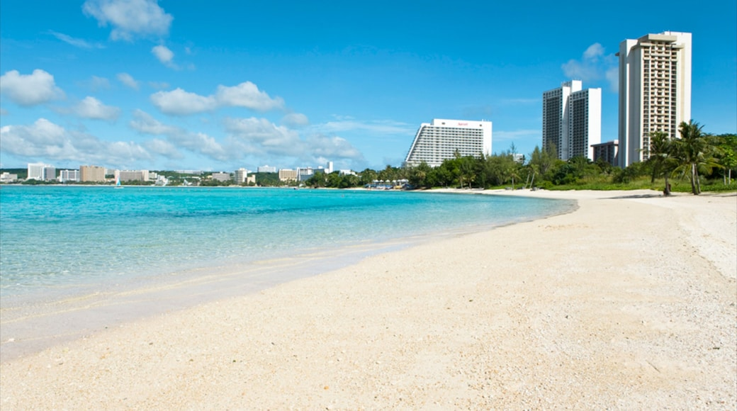 Guam which includes a luxury hotel or resort, tropical scenes and a sandy beach