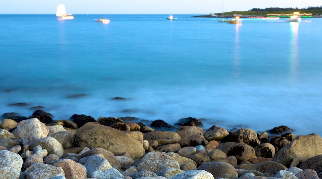 Crystal Crescent Beach which includes rocky coastline and landscape views