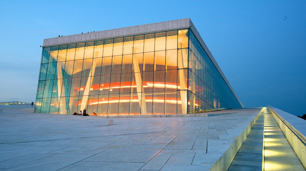 Oslo Opera House which includes night scenes, theatre scenes and modern architecture