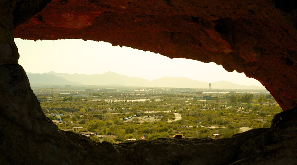 Hole in the Rock which includes desert views and landscape views