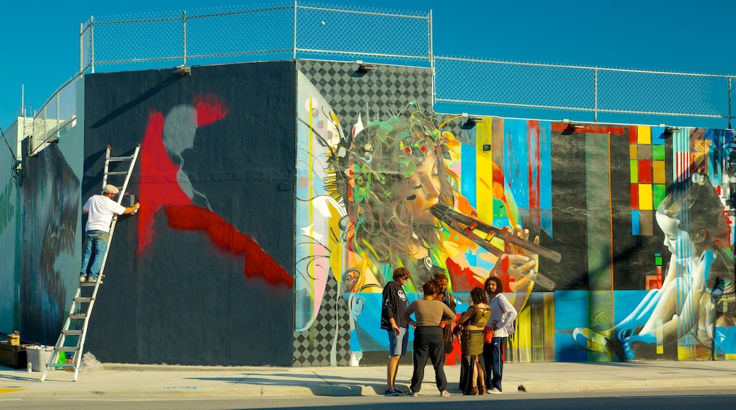 Wynwood Art District showing outdoor art as well as a small group of people