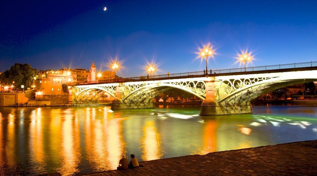 Triana Bridge featuring a city, night scenes and a bridge