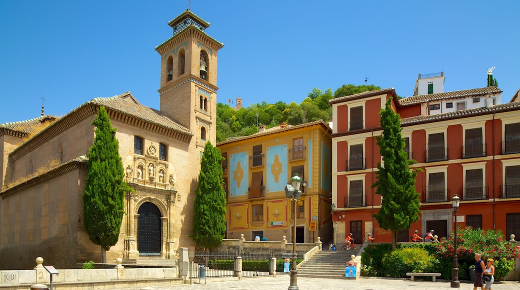 Plaza Nueva which includes a church or cathedral, heritage architecture and a square or plaza