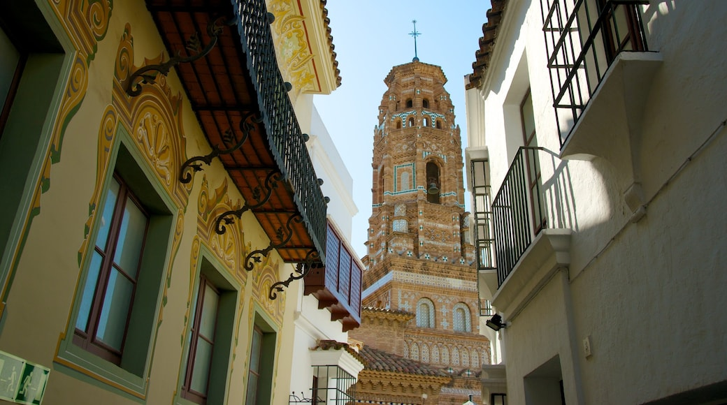 Poble Espanyol which includes a church or cathedral, heritage architecture and a city