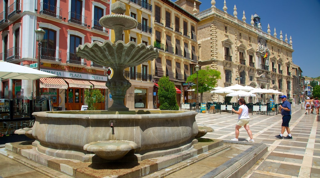 Plaza Nueva featuring a city, a fountain and a square or plaza