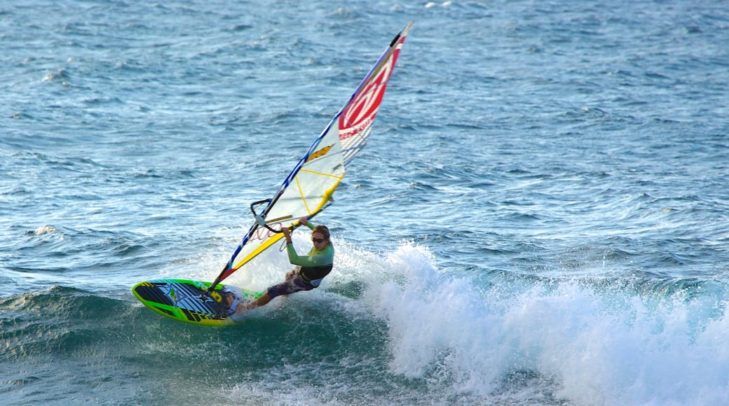 Hookipa Beach Park showing waves and windsurfing as well as an individual male