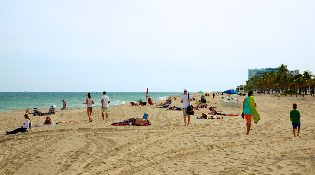 Fort Lauderdale Beach which includes a sandy beach as well as a large group of people