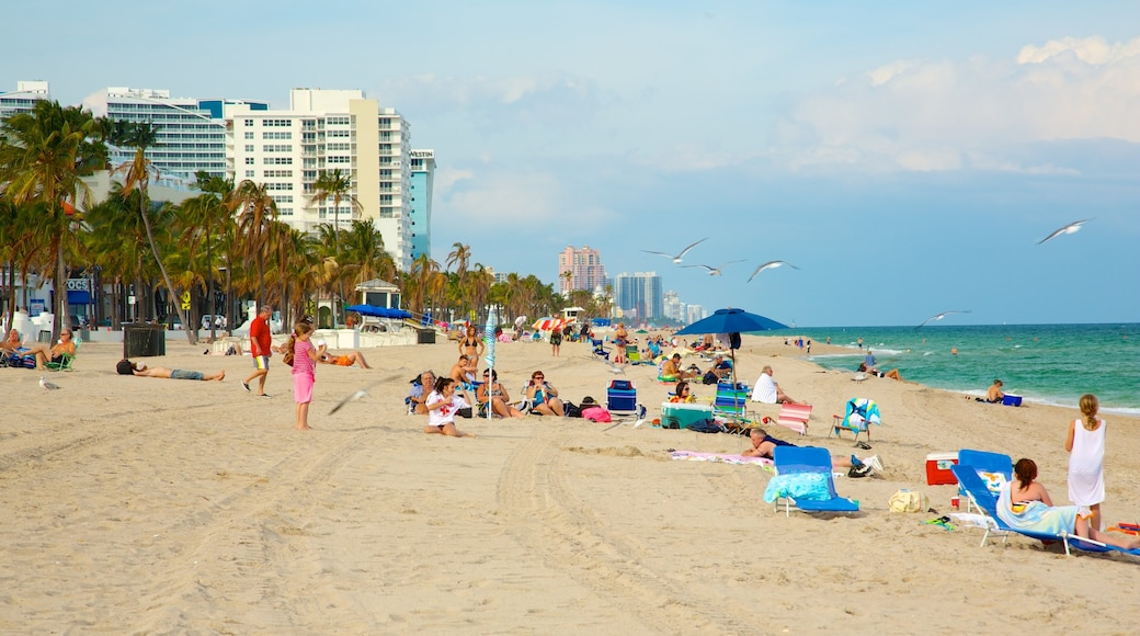 Fort Lauderdale Beach which includes a luxury hotel or resort and a sandy beach as well as a large group of people