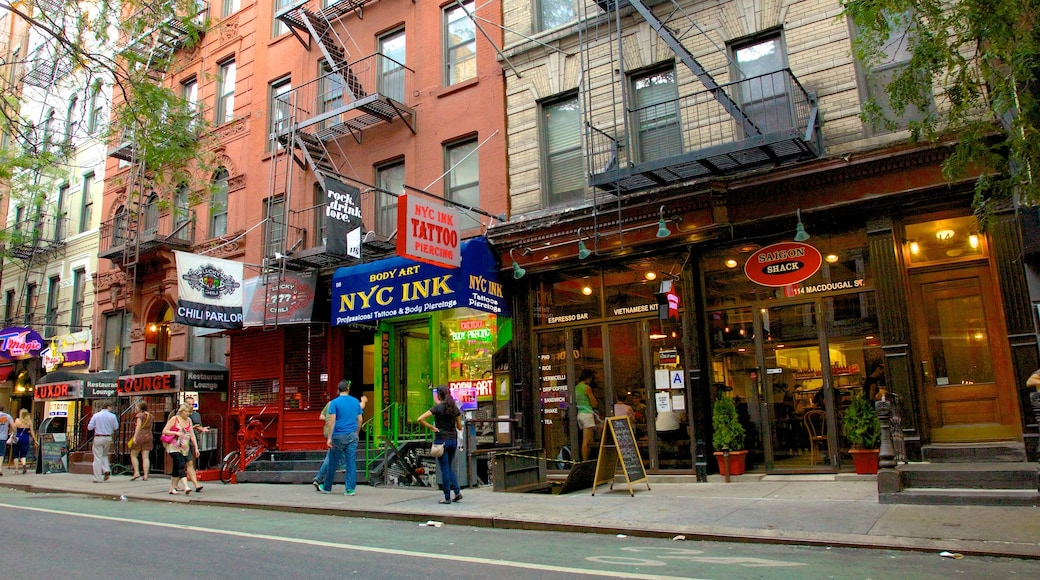 Greenwich Village which includes signage, cafe scenes and street scenes