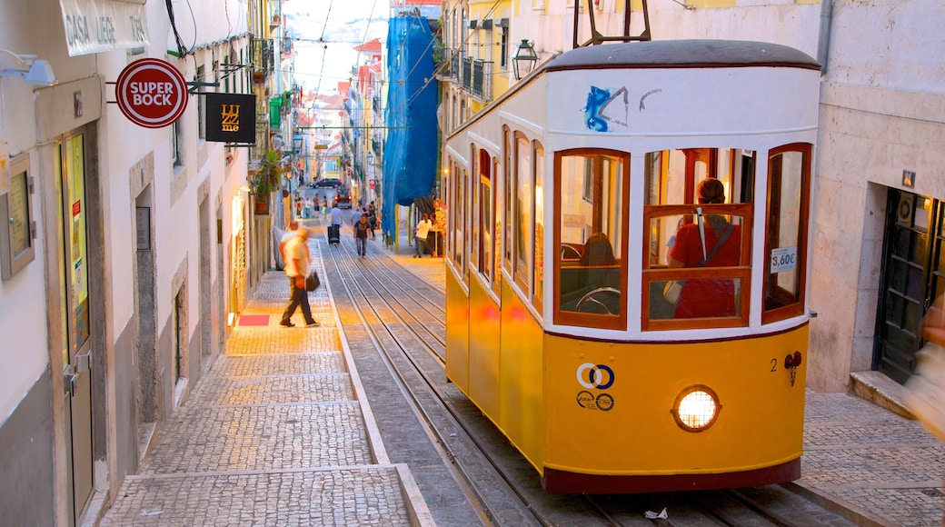 Chiado featuring railway items and a city