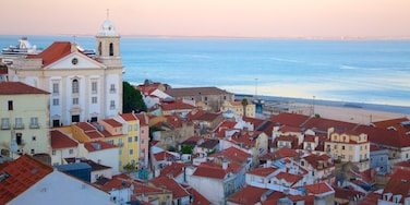Alfama showing a sunset and a coastal town