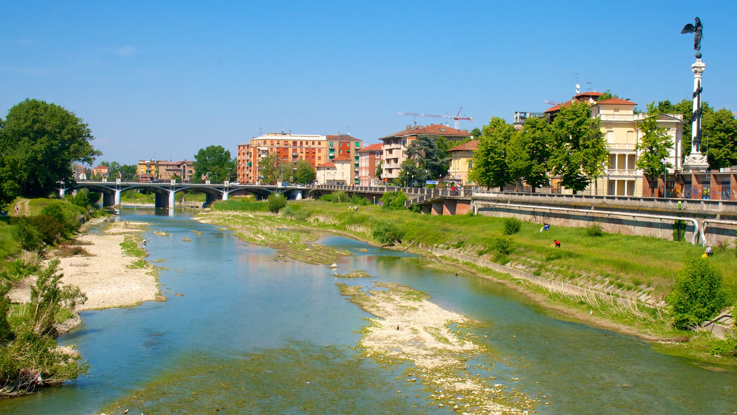 Parma showing a bridge and a river or creek