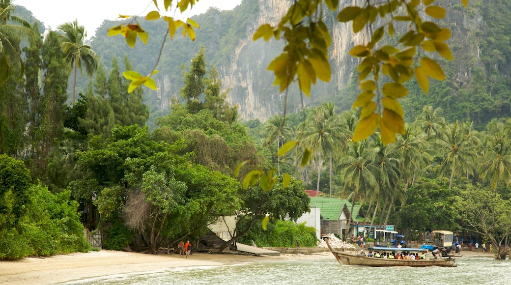 West Railay Beach which includes boating, a sandy beach and tropical scenes
