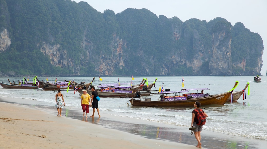 Ao Phra Nang Beach showing boating, mountains and a sandy beach