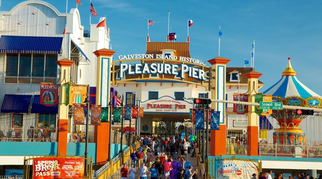 Galveston Island Historic Pleasure Pier featuring rides and signage