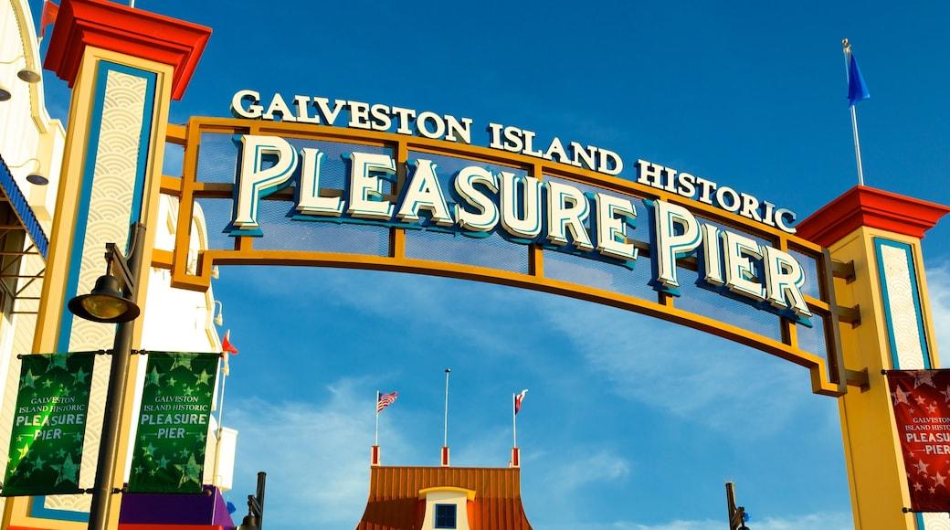 Galveston Island Historic Pleasure Pier showing rides and signage