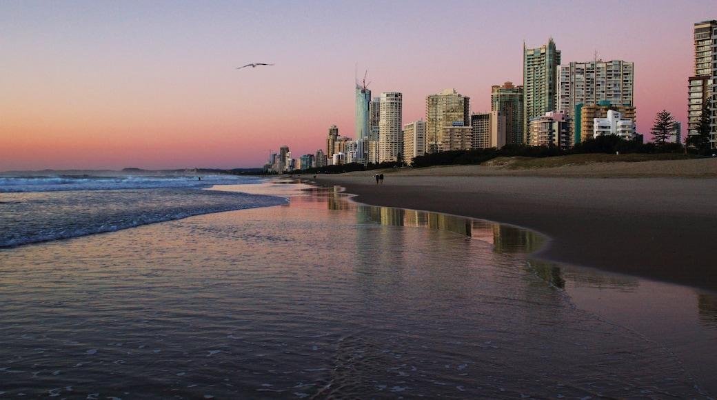 Broadbeach featuring a sunset, a sandy beach and a skyscraper