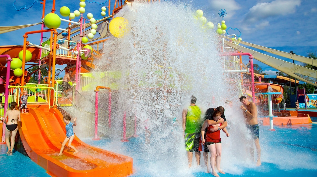 WhiteWater World featuring a water park and a pool as well as a small group of people