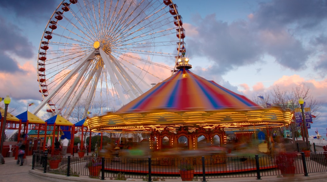 Navy Pier showing a sunset and rides