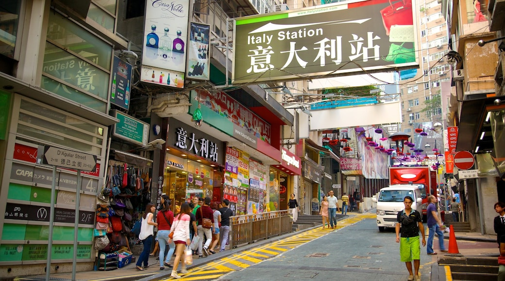 Lan Kwai Fong featuring street scenes, signage and a city