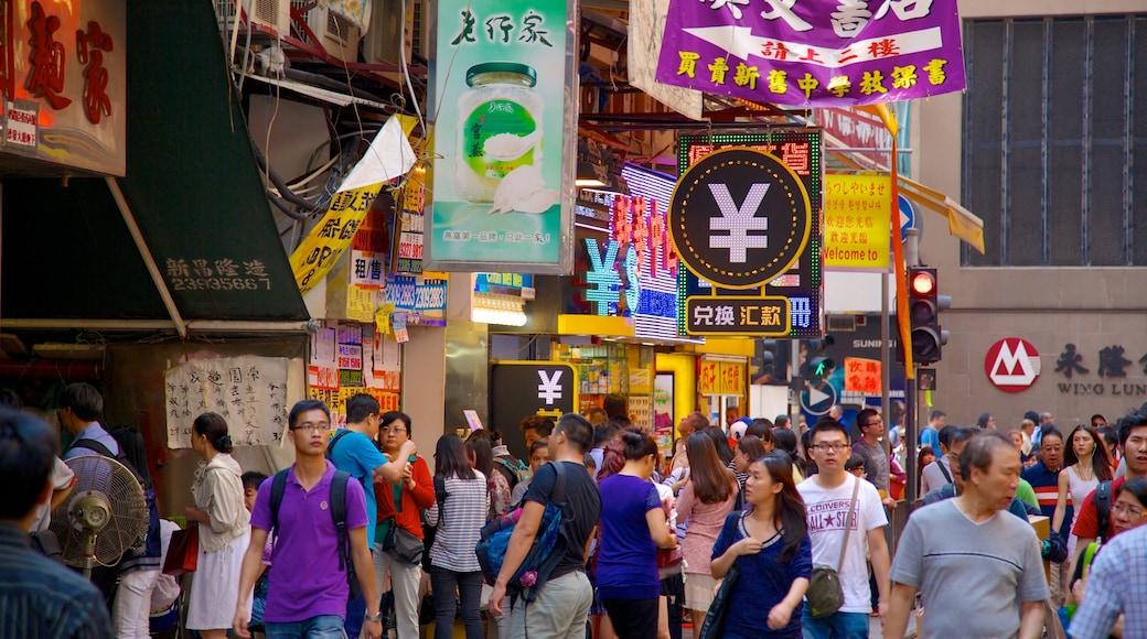 女人街 其中包括 市場 和 指示牌 以及 一大群人